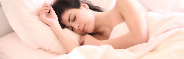 woman sleeping for optimal wellness
